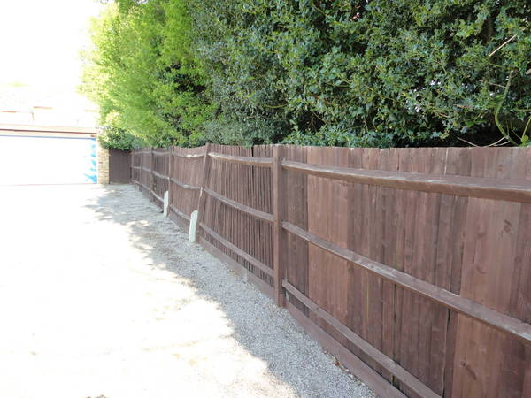 Concrete posts close board fencing before