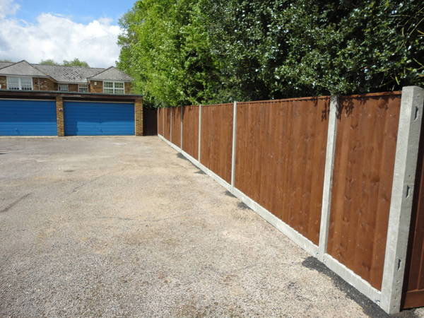 Concrete posts close board fencing after