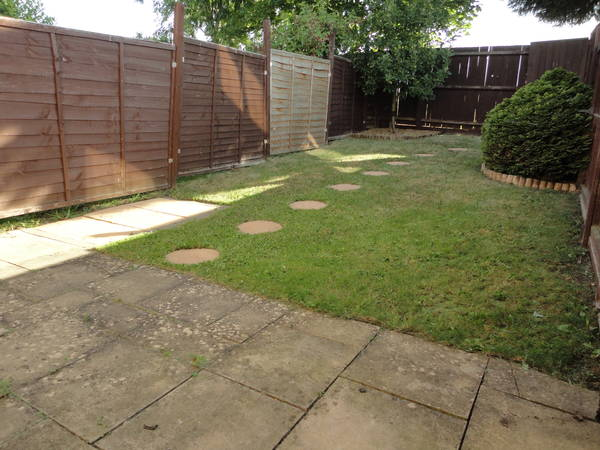 Patio, turf and fence before