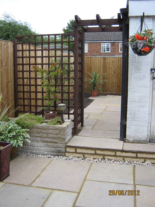 Pergola, paving and step after